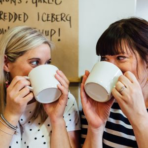 Hayley and Emma drinking tea in a cafe